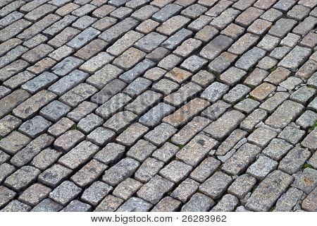 Old English cobblestones road close up.