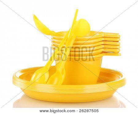 Talheres de plástico amarelo brilhante isolado no branco