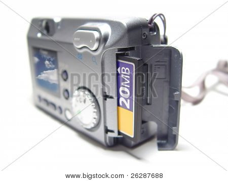 Digital camera with picture of clouds on the screen, and has the memory card out