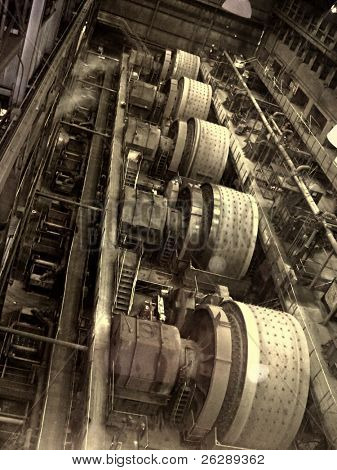 Inside iron ore plant , drum rollers