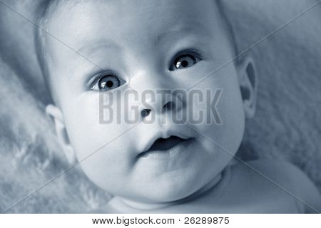 Little Baby Girl closeup of face in blue