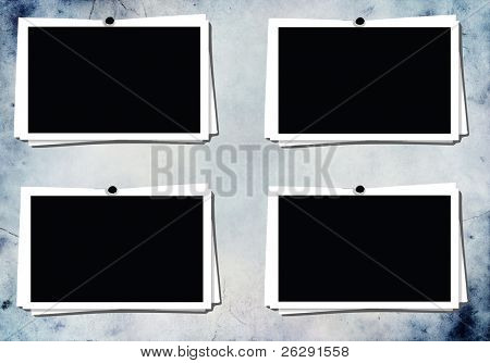 vintage blank photo frames on background