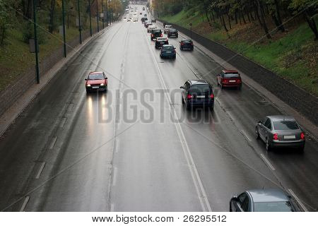 Cars passing by on a wet road in the rain