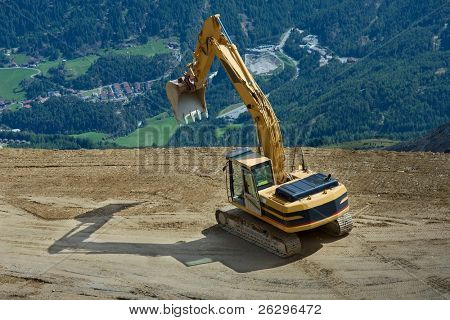 excavator at a construction high up in the mountains