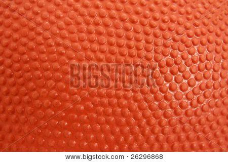 Primer plano detallado de la textura de una pelota de baloncesto
