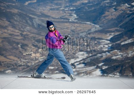 Female skier on the top of the slope