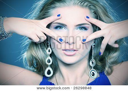 Portrait of a beautiful woman. Jewelry, make-up.