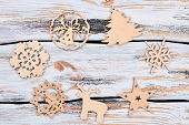 New Year Cutout Wooden Figures. Circle From Handmade Carved Wooden Christmas Silhouettes On Old Wood poster
