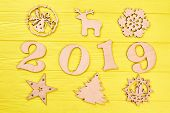 Wooden Digit 2019 And New Year Silhouettes. Cut Out Wooden Number 2019 And Christmas Wooden Ornament poster