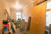 Ladders, Bags With Putty, Construction Tools And Materials, Sheets Of Drywall Are In An  Apartment I poster