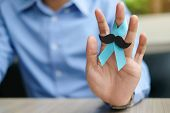 Prostate Cancer Awareness, Man Hand Holding Light Blue Ribbon With Mustache For Supporting People Li poster