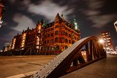 Old Speicherstadt In Hamburg Illuminated At Night. Arch Bridge And Historical Buildings. Warehouse D poster