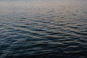Light Playing On The Sea Surface. Water Surface. Sea Surface. Water Background. Blue Water Surface.  poster