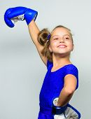 Strong Child Concept. Kid Strong And Healthy. Girl Child Strong With Boxing Gloves Posing On Grey Ba poster