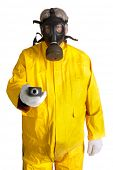 stock photo of geiger  - Man in a rubber hazmat suit wearing a gas mask and holding a geiger counter - JPG