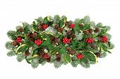 Christmas and winter natural table decoration with holly berries, snow covered spruce pine, ivy, pin poster