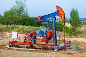 The Oil Pump, Industrial Equipment. Oil Field Site, Oil Pumps Are Running. Rocking Machines For Oil  poster