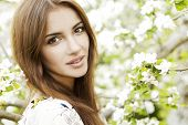 stock photo of beautiful face  - Beautiful Spring Brunette Girl with flowers - JPG