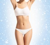 Young, Sporty, Fit And Healthy Girl Over Winter Background. Sporty Female Body In White Slimming Und poster
