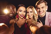 Cheerful Glamorous Multicultural Friends Taking Selfie On Black With Backlit poster