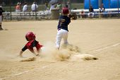 stock photo of hustle  - Little league baseball player sliding into third base - JPG