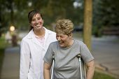 image of physical therapist  - Physical therapist laughs with a patient - JPG