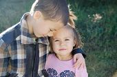 Boy And Little Girl Hugging Portrait. Happy Smiling Children Outdoors At Sunny Day.friendship Siblin poster