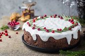 Traditional Christmas Cake With Fruits, Nuts And White Glaze With Christmas Decorations poster
