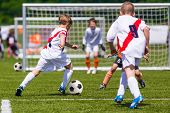 Training And Football Match Between Youth Soccer Teams. Young Boys Playing Soccer Game. Hard Competi poster
