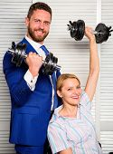 Key To Success Concept. Man And Woman Raise Heavy Dumbbells. Strong Powerful Business Strategy. Boss poster