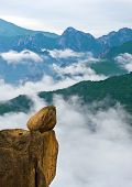 stock photo of seoraksan  - Hanging stone at the Ulsanbawi Rock against the fog seorak  mountains at the Seoraksan National Park - JPG