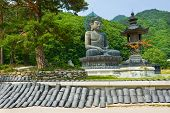 stock photo of seoraksan  - Giant statue of Buddha and memorial plates in the Sinheungsa Temple in Seoraksan National Park - JPG