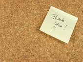foto of thank you note  - Handwritten thank you on yellow note paper stick on a corkboard - JPG