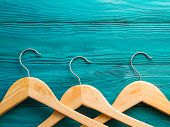 Wooden Hangers On Green Background. What, Nothing To Wear. Wardrobe Building Concept. Shopping, Sale poster