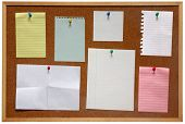 picture of bulletin board  - Paper on an isolated cork notice board - JPG