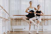 Ballet Training Of Little Girl With Teacher Indoor. Classical Ballet. Girl In Balerina Tutu. Trainin poster