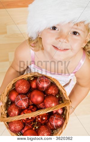 Little Girl With Christmas Balls