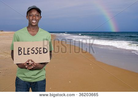 Man Holding Sign That Says Blessed