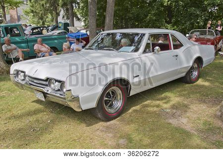 White 1967 Cutlass F85 Car
