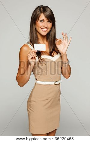 Beautiful business woman showing empty credit card