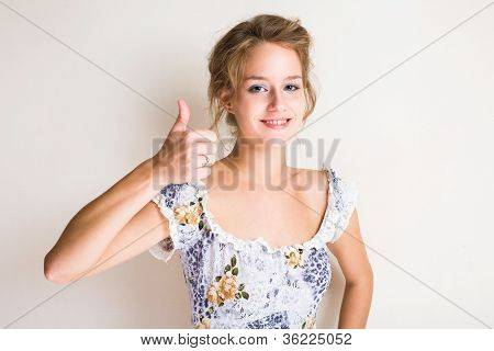 Cute Young Blond Showing Thumbs Up.