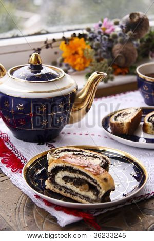 Tea and roll with poppy seeds