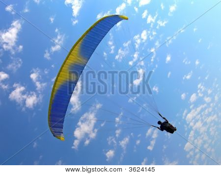 Paraglide On A Blue Sky