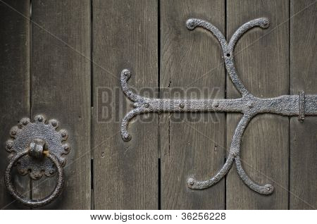 Wrought Iron Metal Work On Ald Wooden Door