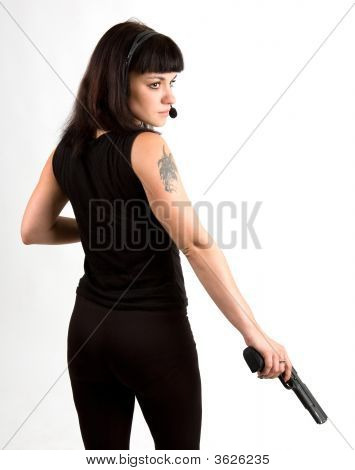 Girl With Gun And Headphones