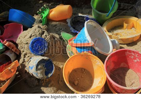 Gaily Coloured Toys In A Sandbox