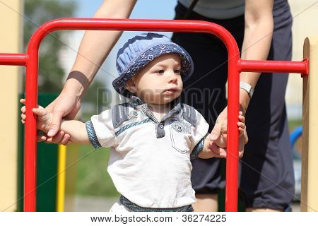 Child With Mom At Playground