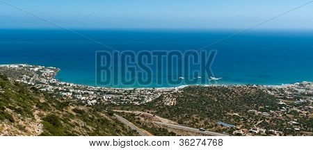 Panoramic View On Malia Town Coastline