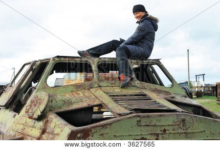 The Cheerful Girl On The Old Cross-Country Vehicle