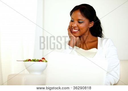 Charming Black Woman Looking Down To Her Salad